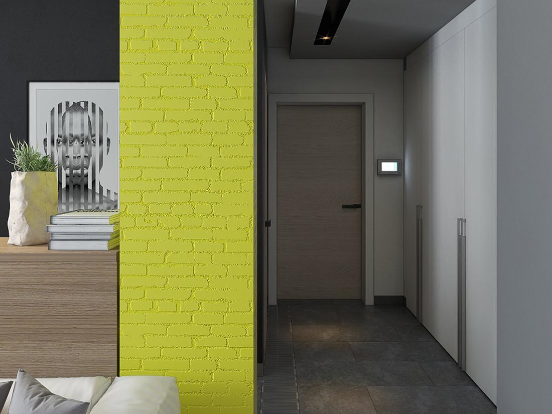 Минск. Неманская. Дизайн квартиры-студии в стиле лофт. Прихожая. Стильные белые шкафы. Желтая колонна из декоративного кирпича.